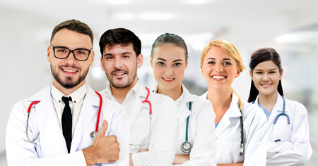 Healthcare people group. Professional doctor working in hospital office or clinic with other doctors, nurse and surgeon. Medical technology research institute and doctor staff service concept. Reklamní fotografie - 124824529