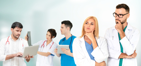 Healthcare people group. Professional doctor working in hospital office or clinic with other doctors, nurse and surgeon. Medical technology research institute and doctor staff service concept. Reklamní fotografie - 124824532