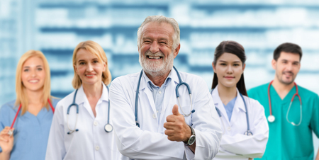 Healthcare people group. Professional doctor working in hospital office or clinic with other doctors, nurse and surgeon. Medical technology research institute and doctor staff service concept. Reklamní fotografie - 124824540