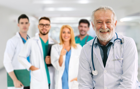 Healthcare people group. Professional doctor working in hospital office or clinic with other doctors, nurse and surgeon. Medical technology research institute and doctor staff service concept. Reklamní fotografie - 124824548