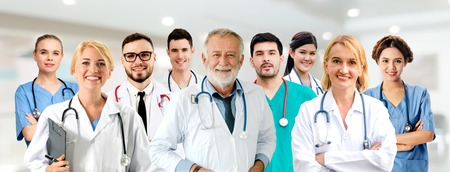 Healthcare people group. Professional doctor working in hospital office or clinic with other doctors, nurse and surgeon. Medical technology research institute and doctor staff service concept. Reklamní fotografie - 124824551