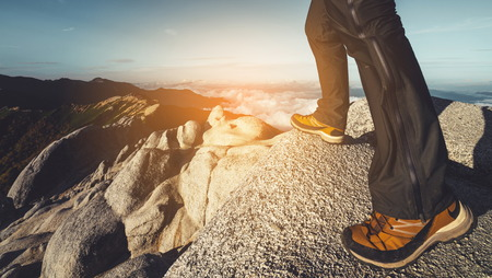 Epic adventure of hiker do trekking activity in mountain of Northern Japan Alps, Nagano, Japan, with panoramic nature mountain range landscape. Motivation leisure sport and discovery travel concept. Stock Photo
