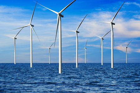 Wind turbine farm power generator in beautiful nature landscape for production of renewable green energy is friendly industry to environment. Concept of sustainable development technology. Standard-Bild - 124822387