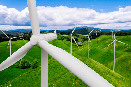 Wind turbine farm power generator in beautiful nature landscape for production of renewable green energy is friendly industry to environment. Concept of sustainable development technology. Standard-Bild - 124822389