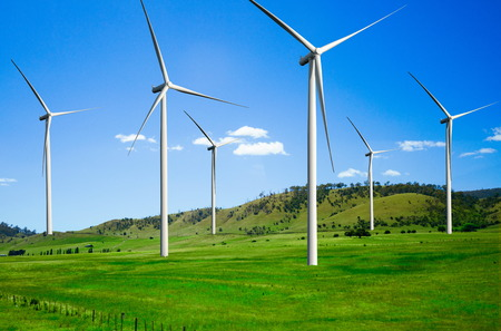 Wind turbine farm power generator in beautiful nature landscape for production of renewable green energy is friendly industry to environment. Concept of sustainable development technology. Standard-Bild - 124822392