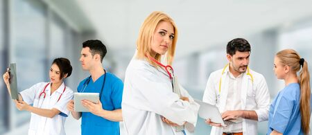 Healthcare people group. Professional doctor working in hospital office or clinic with other doctors, nurse and surgeon. Medical technology research institute and doctor staff service concept. Imagens - 124946212