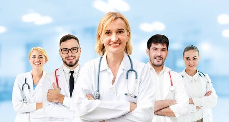 Healthcare people group. Professional doctor working in hospital office or clinic with other doctors, nurse and surgeon. Medical technology research institute and doctor staff service concept. Imagens - 124946215