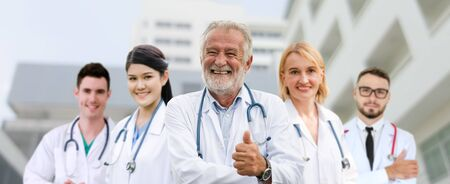 Healthcare people group. Professional doctor working in hospital office or clinic with other doctors, nurse and surgeon. Medical technology research institute and doctor staff service concept. Imagens - 124946923
