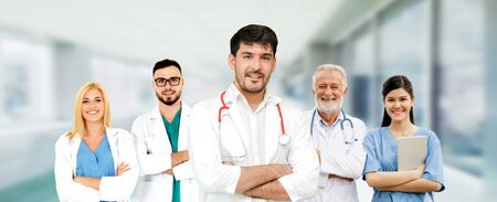Healthcare people group. Professional doctor working in hospital office or clinic with other doctors, nurse and surgeon. Medical technology research institute and doctor staff service concept. Imagens - 124946930