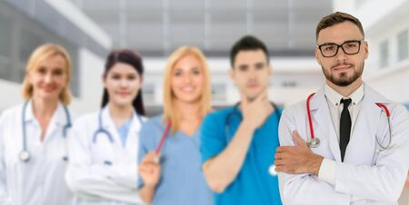 Healthcare people group. Professional doctor working in hospital office or clinic with other doctors, nurse and surgeon. Medical technology research institute and doctor staff service concept. Imagens - 124946931