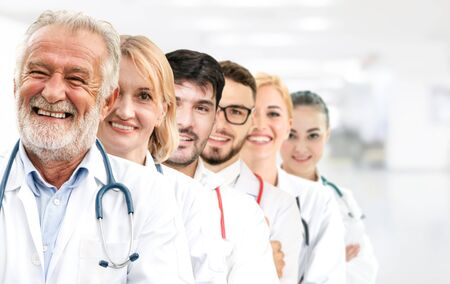 Healthcare people group. Professional doctor working in hospital office or clinic with other doctors, nurse and surgeon. Medical technology research institute and doctor staff service concept. Imagens - 124947309