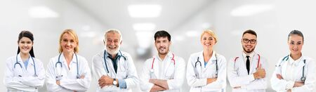 Healthcare people group. Professional doctor working in hospital office or clinic with other doctors, nurse and surgeon. Medical technology research institute and doctor staff service concept. Imagens - 124947515