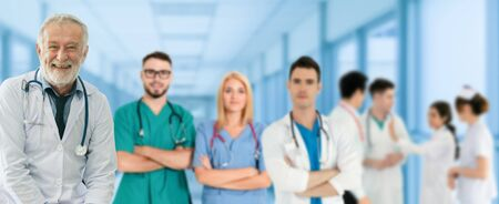 Healthcare people group. Professional doctor working in hospital office or clinic with other doctors, nurse and surgeon. Medical technology research institute and doctor staff service concept. Imagens - 124947522