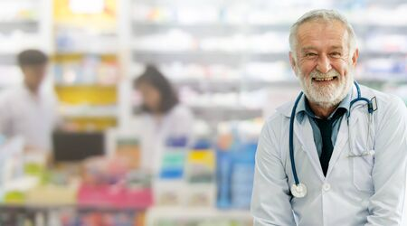 Senior male pharmacist working at the pharmacy. Medical healthcare and pharmaceutical service. Stok Fotoğraf