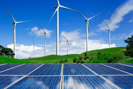 Solar energy panel photovoltaic cell and wind turbine farm power generator in nature landscape for production of renewable green energy is friendly industry. Clean sustainable development concept.