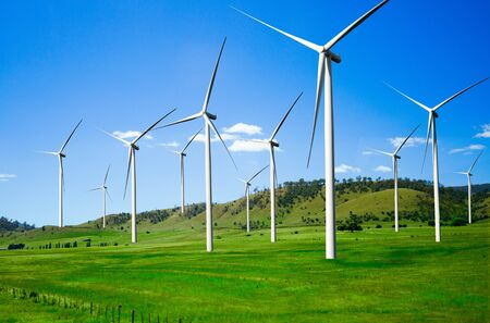 Wind turbine farm power generator in beautiful nature landscape for production of renewable green energy is friendly industry to environment. Concept of sustainable development technology. Stock Photo
