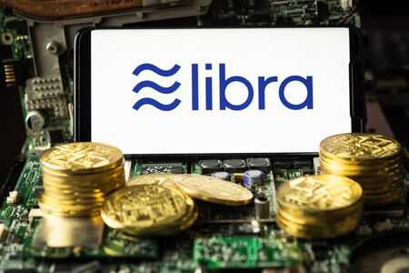 Bangkok, Thailand - July 2, 2019: Phone shows Libra logo on the screen. Facebook reported to utilize new cryptocurrency called Libra. Libra was reported to be used for purchases in Facebook and other.