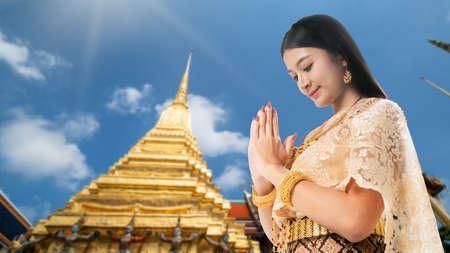 Beautiful Thai woman portrait dress up in traditional thai costume at Temple of the Emerald Buddha or Wat Phra Kaew in Bangkok, Thailand. Stock fotó