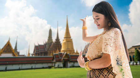 Beautiful Thai woman portrait dress up in traditional thai costume at Temple of the Emerald Buddha or Wat Phra Kaew in Bangkok, Thailand. Stock fotó - 150637453