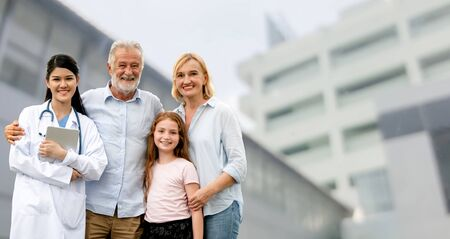 Doctor with happy family of mother, father and daughter at the hospital. Medical healthcare and doctor service. Zdjęcie Seryjne
