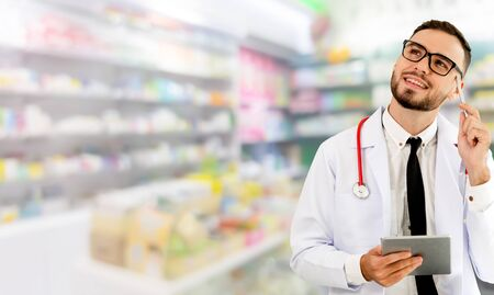 Pharmacist using tablet computer at the pharmacy. Medical healthcare and pharmaceutical staff service. Stok Fotoğraf