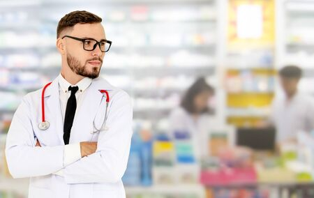 Young male pharmacist working at the pharmacy. Medical healthcare and pharmaceutical service. Stok Fotoğraf
