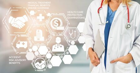 Health Insurance Concept - Doctor in hospital with health insurance related icon graphic interface showing healthcare people, money planning, risk management, medical treatment and coverage benefit. Zdjęcie Seryjne - 128903791