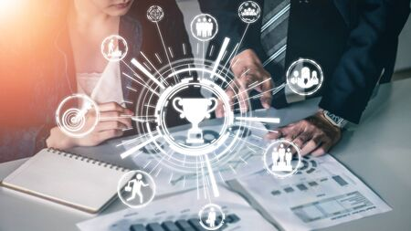 Achievement and Business Goal Success Concept - Creative business people with icon graphic interface showing employee reward giving for business success achievement. 版權商用圖片
