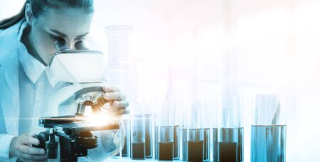 Research and development concept. Double exposure image of scientific and medical lab instrument, microscope, test tube and glass flask for microbiology and chemistry in laboratory for medicine study. 写真素材 - 128879774