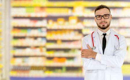 Young male pharmacist working at the pharmacy. Medical healthcare and pharmaceutical service. Zdjęcie Seryjne