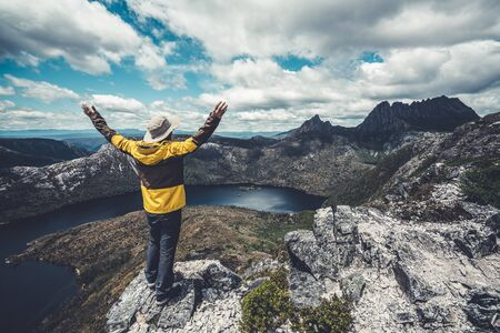 Traveller man explore landscape of Marions lookout trail in Cradle Mountain National Park in Tasmania, Australia. Summer activity and people adventure.