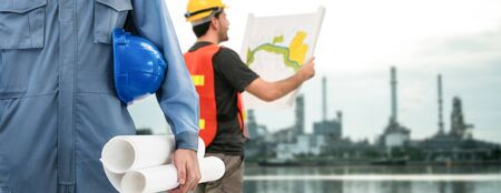 Industry worker or engineer working on industry project at work site. Engineering people solution service concept.