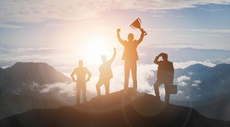 Achievement and Business Goal Success Concept - Creative business people with icon graphic interface showing employee reward giving for business success achievement. Imagens
