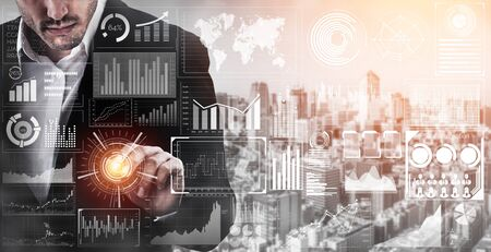 Big Data Technology for Business Finance Analytic Concept. Modern graphic interface shows massive information of business sale report, profit chart and stock market trends analysis on screen monitor. Imagens