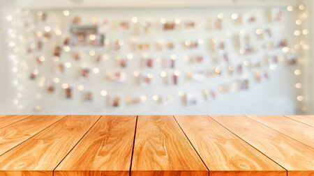 Wood table in blurry background of modern restaurant room or coffee shop with empty copy space on the table for product display mockup. Interior restaurant counter design concept. 写真素材