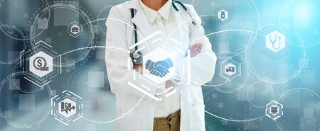 Health Insurance Concept - Doctor in hospital with health insurance related icon graphic interface showing healthcare people, money planning, risk management, medical treatment and coverage benefit. Zdjęcie Seryjne - 128903917