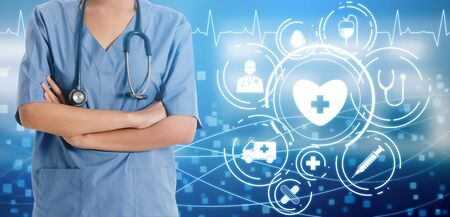 Medical Healthcare Concept - Doctor in hospital with digital medical icons graphic banner showing symbol of medicine, medical care people, emergency service network, doctor data of patient health. Stock fotó