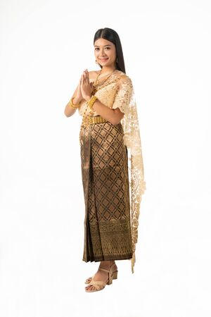 Beautiful Thai woman portrait dress up in traditional thai costume on white background. Thailand culture concept. Stock Photo