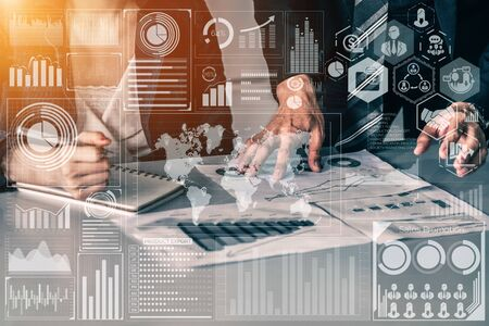 Big Data Technology for Business Finance Analytic Concept. Modern graphic interface shows massive information of business sale report, profit chart and stock market trends analysis on screen monitor. Stockfoto
