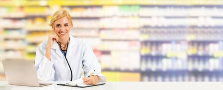 Pharmacist or doctor using laptop computer at the pharmacy room. Medical healthcare and pharmaceutical staff service. Stockfoto