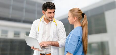 Doctors at hospital office working with another doctor. Healthcare and medical services. Imagens