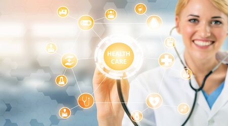 Medical Healthcare Concept - Doctor in hospital with digital medical icons graphic banner showing symbol of medicine, medical care people, emergency service network, doctor data of patient health. 写真素材