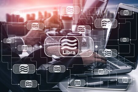 Libra cryptocurrency coin newly introduced to world digital money economy. Libra was reported to be used for electronic payment on many partner internet website. Фото со стока