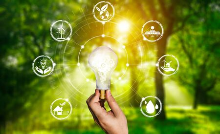 Green energy innovation light bulb with future industry of power generation icon graphic interface. Concept of sustainability development by alternative energy. Standard-Bild