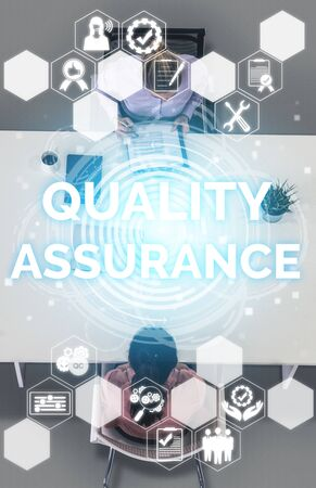 Quality Assurance and Quality Control Concept - Modern graphic interface showing certified standard process, product warranty and quality improvement technology for satisfaction of customer. Banco de Imagens