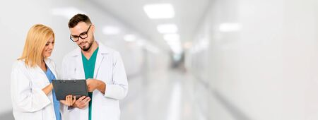 Doctor working with another doctor in the hospital. Healthcare and medical service. Stock fotó