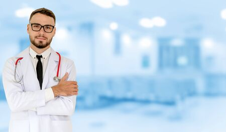 Young male doctor working at the hospital. Medical healthcare and doctor staff service. Stock fotó