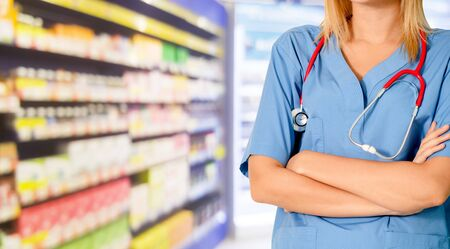 Woman pharmacist working at pharmacy. Medical healthcare and doctor staff service. Imagens