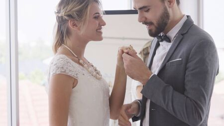 Happy bride and groom in wedding dress prepare for married in wedding ceremony. Romantic love of man and woman couple. 版權商用圖片
