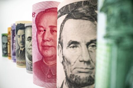 Macro shot of international currency money include US American Dollar, Euro Currency, British UK Pound, Australian Dollar, China Yuan and Japan Yen. Foreign currency money exchange and Forex concept. Stock Photo